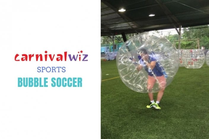 Picture of a male and female each in a bubble bumper rental suit ready to play soccer in Singapore