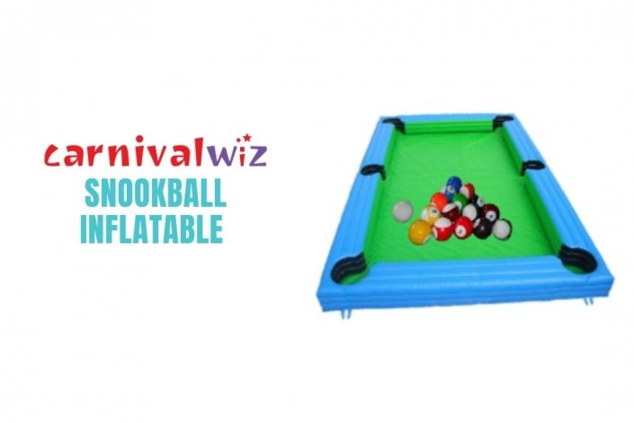 Picture of giant sized inflatable pool table with soccer balls